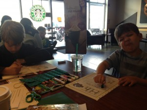 Always a goofball, here's Lucas (right) doing school at Starbucks