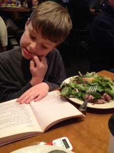 William eating steak salad