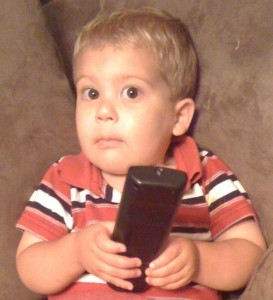 Lucas with remote, age 2