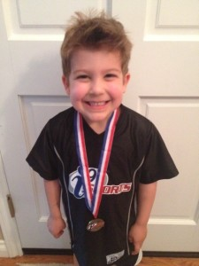 Lucas with flag football medal